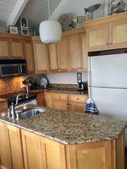 Remodeled kitchen with granite countertops.