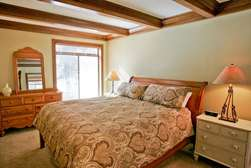 Master Bedroom with King bed, electric mattress firmness controls, flat panel TV
