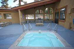 Outdoor jacuzzi and BBQ area in central complex building