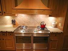 Kitchen with island, 6 burner gas stove, & stainless steel appliances