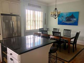 Dining table is adjacent to the open kitchen.