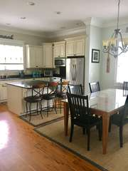 Dining table is adjacent to the kitchen.