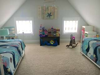 Kids room with daybeds and trundles.