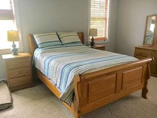 Second floor master bedroom has a queen size bed an HDTV and a dresser to store your necessities.