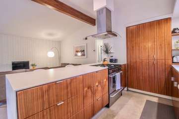 Gourmet Kitchen with Stainless Appliances, Dishes, and Cookware.