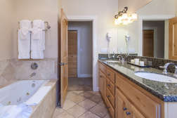 Master bathroom with dual vanity, Jacuzzi tub and stand alone shower.
