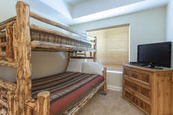 guest bedroom with one set of bunk beds (Twin over Queen beds) and flat screen TV