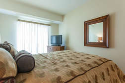 Guest bedroom with Queen bed, flat screen TV and private patio entrance