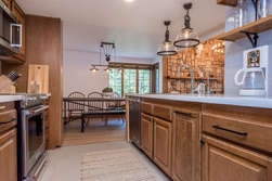 Fully Equipped Kitchen with Ceasarstone Counter tops and Stainless Steel Appliances and dining table for 8-9 people
