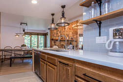 Fully Equipped Kitchen with Cesar Stone Counter tops and Stainless Steel Appliances and dining table for 8-9 people