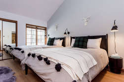 Master Bedroom Downstairs with two Queen Beds and En-suite Bathroom