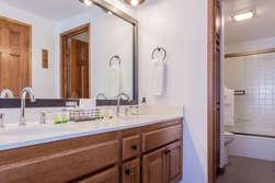 First Bathroom -En-suite Master Bathroom- Double Vanity Sinks and Shower and Tub