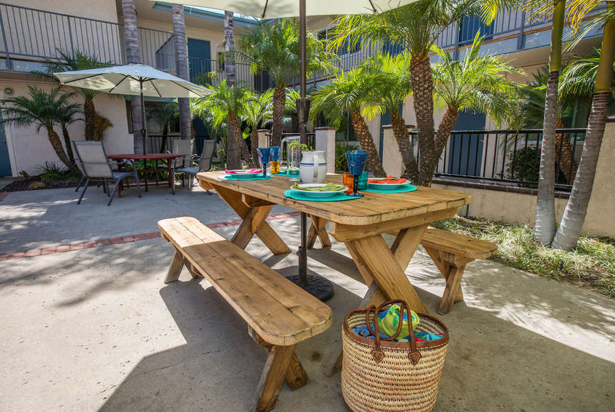 Set out a picnic by the BBQ in pool area