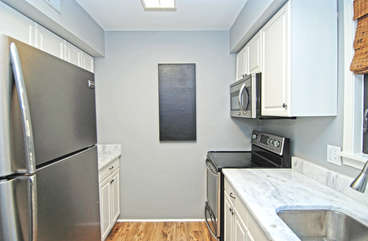 Updated kitchen with granite counter tops, stainless steel appliances and new cabinets.