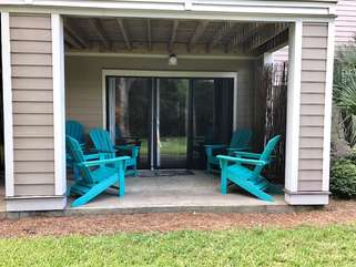 Enjoy the covered patio with adirondak chairs.