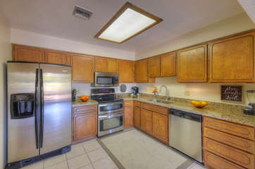 Family chef will love working in fully stocked kitchen with new stainless steel appliances and natural light from skylight
