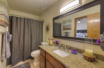 Second bathroom features  a newly refinished vanity with granite top and tub/shower combination