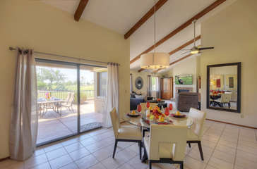 Dining area has golf course views and doors that access back patio