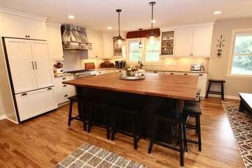 Gourmet kitchen with Thermador Built-in Refrigerator, Thermador 6 burner gas stove, m/w & large butcher block island that sits 6
