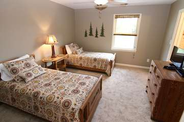 Bedroom with 2 single beds & TV connecting to bathroom leading to 2nd master suite-upper level