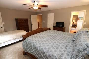 2nd Master suite w/king bed, roll away single bed option w/linens, & TV, leads to full bathroom that connects w/bedroom that has 2 single beds-upper level