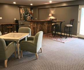 Recreational room with game table and bar-lower level