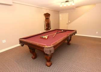 Full size pool table in recreational room-lower level