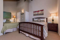 Open loft/bedroom with 2 queen size beds and flat screen TV
