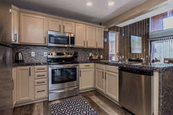 Updated Kitchen- Fully Equipped- Granite Counter Tops and Stainless Steel Appliances!