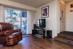 Entryway, flat screen TV and private patio