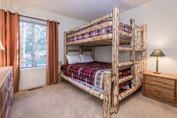 Guest bedroom (Bunk room) with Full bed over Queen bed and flat screen TV