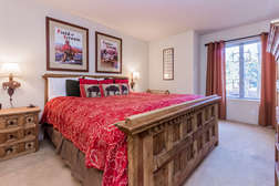 Master bedroom with flat screen TV and master bath en-suite