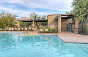 Sizable heated community pool invites you for a playful dip or lap swimming