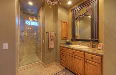 Walk in glass shower is another appealing feature of upper level master bath