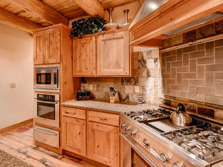 Fully stocked for all basic cooking needs, dual ovens, custom countertops