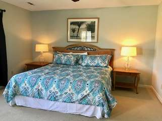 The master bedroom has a king size bed, an HDTV and an en suite bathroom.