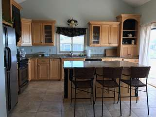 There is plenty of room for everyone to gather in the kitchen.