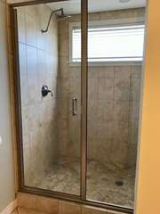 A large walk-in shower completely tiled.