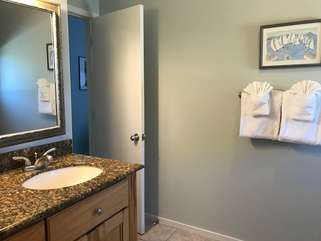 The en suite bathroom for the second bedroom also serves as the hall bathroom.