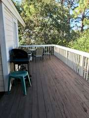 The back deck has a gas grill and a patio table that seats 4.