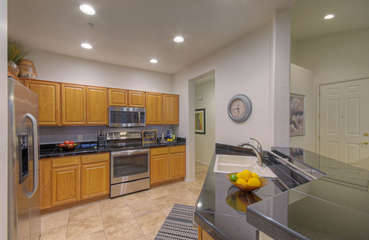 Kitchen opens into great room so chef is included in the fun and snacks and beverages are easy to serve