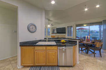 Open floor plan makes great room an inviting place for meals, conversation, laughter and more