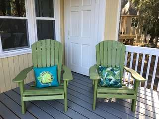 Brightly colored chairs greet you as you come up the stairs.