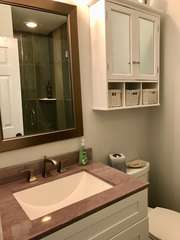 The master bathroom vanity has been updated with a granite top. There is plenty of storage for your necessities.
