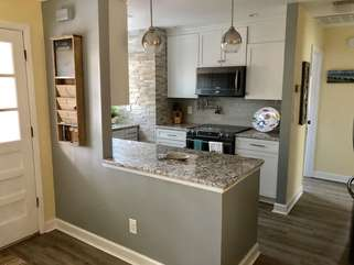 Kitchen opens to dining room and living area.