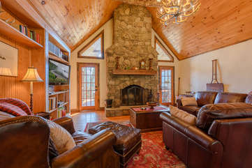Great Room with Stone Fireplace, Vaulted Tongue & Groove Ceiling