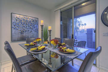 Double doors in dining room lead to recently remodeled patio and offer enticing view of golf course