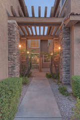 Front entry to 2 story condo in safe and friendly gated community