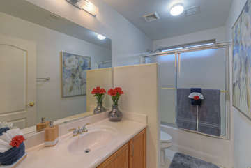 Second bath with a tub/shower combination is also upstairs and is shared by second and third bedrooms