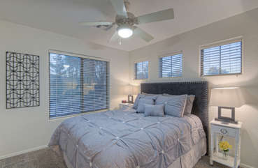 Third bedroom has queen bed, ceiling fan and double closet